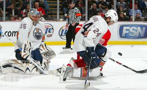 Steve Staios in action as an Edmonton Oiler, doing what he does best: taking pain blocking a shot
